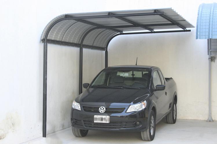 Curvin cubrecochera ala for Modelos de techos para cocheras